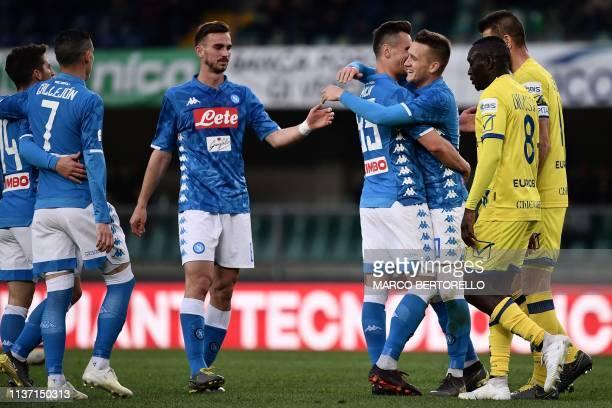 Napoli's Polish forward Arkadiusz Milik celebrates with Napoli's Polish midfielder Piotr Zielinski after scoring during the Italian Serie A football...