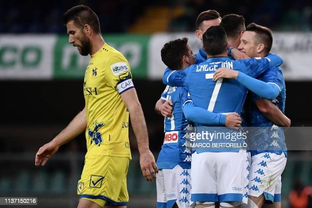 Napoli's Polish forward Arkadiusz Milik celebrates with teammates after scoring during the Italian Serie A football match Chievo Verona vs Napoli on...