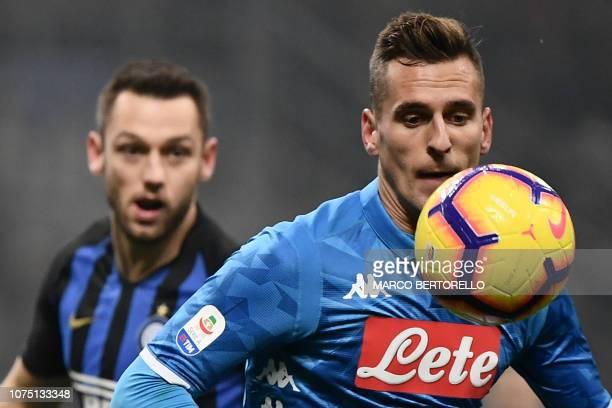 Napoli's Polish forward Arkadiusz Milik controls the ball ahead of Inter Milan's Dutch defender Stefan de Vrij during the Italian Serie A football...