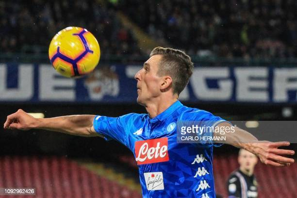 Napoli's Polish forward Arkadiusz Milik eyes the ball during the Italian Serie A football match Napoli vs Sampdoria on February 2 2019 at the San...