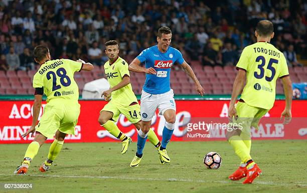 Napoli's Polish forward Arkadiusz Milik in action during the Italian Serie A football match SSC Napoli vs Bologna FC on September 17 2016 at the San...