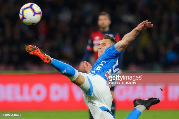 Napoli's Polish forward Arkadiusz Milik kicks the ball during the Italian Serie A football match Napoli vs Genoa on April 7 2019 at the San Paolo...
