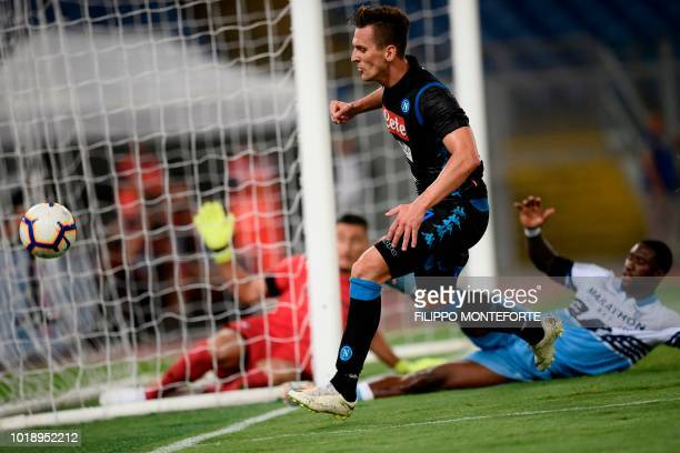 Napoli's Polish forward Arkadiusz Milik misses a shot during the Italian Serie A football match Lazio vs Napoli at the Olympic stadium in Rome on...