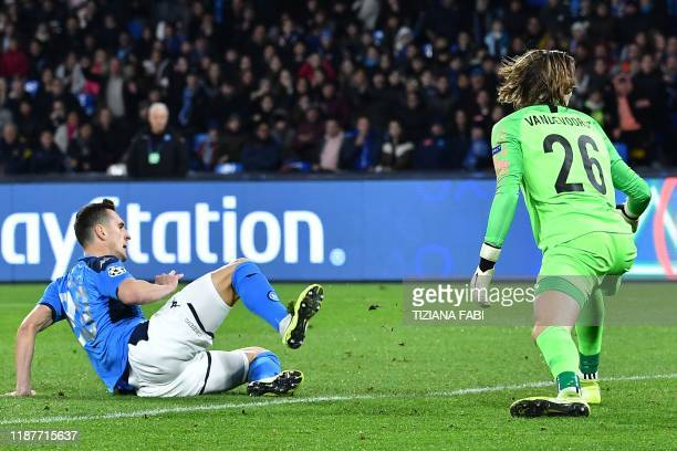 Napoli's Polish forward Arkadiusz Milik opens the scoring past RC Genk's Belgian goalkeeper Maarten Vandevoordt during the UEFA Champions League...