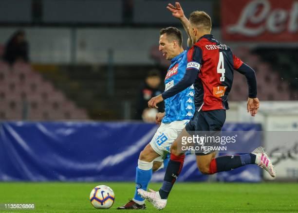 Napoli's Polish forward Arkadiusz Milik outruns Genoa's Italian defender Domenico Criscito during the Italian Serie A football match Napoli vs Genoa...