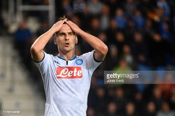 Napoli's Polish forward Arkadiusz Milik react during the UEFA Champions League Group E football match between Napoli and RC Genk on October 02 2019...