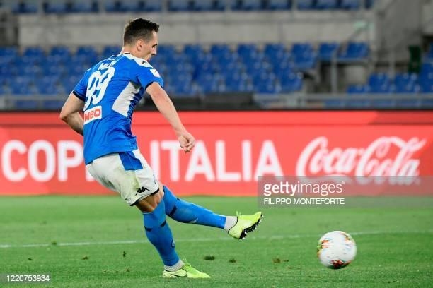Napoli's Polish forward Arkadiusz Milik shoots to score the winning goal of the penalty shootout for Napoli to win the TIM Italian Cup final football...