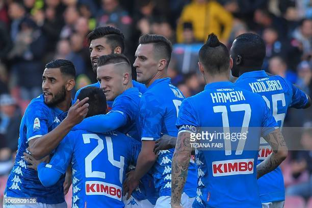 Napoli's Polish midfielder Piotr Zielinski and his teammates celebrate after scoring against Frosinone during the Italian Serie A football match on...