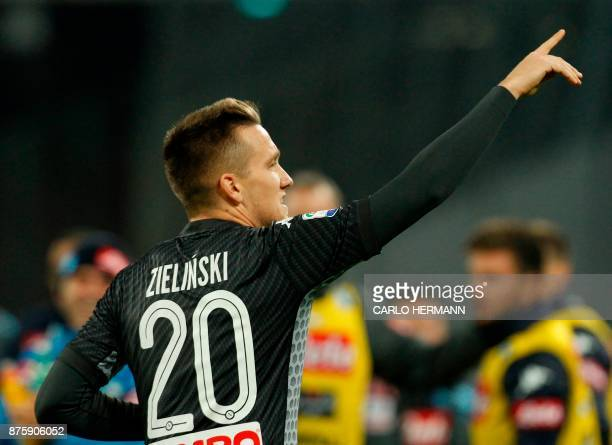 Napoli's Polish midfielder Piotr Zielinski celebrates after scoring during the Italian Serie A football match SSC Napoli vs AC Milan on November 18...