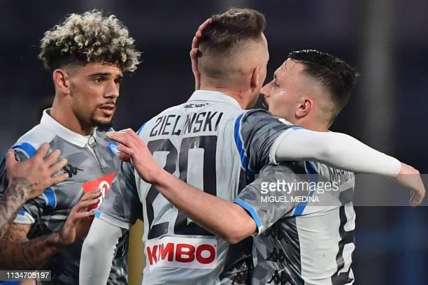 Napoli's Polish midfielder Piotr Zielinski celebrates with Napoli's FrenchMoroccan defender Kevin Malcuit and Napoli's Portuguese defender Mario Rui...