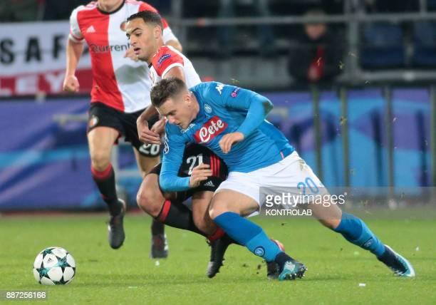 STADIUM ROTTERDAM NETHERLANDS Napoli's Polish midfielder Piotr Zielinski fights for the ball with Feyenoord's Moroccan midfielder Sofyan Amrabat...