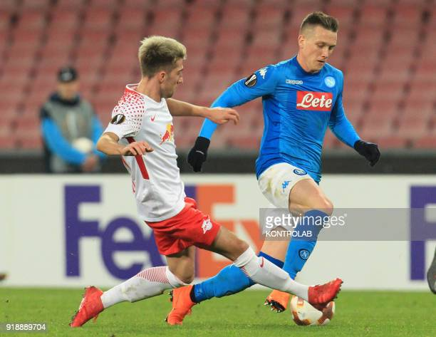 STADIUM NAPLES CAMPANIA ITALY Napoli's Polish midfielder Piotr Zielinski fights for the ball with Leipzig's Brazilian midfielder Kevin Kampl during...