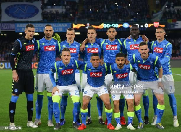 Napoli's Polish midfielder Piotr Zielinski Napoli's Brazilian midfielder Allan Napoli's Italian forward Lorenzo Insigne and Napoli's Spanish...