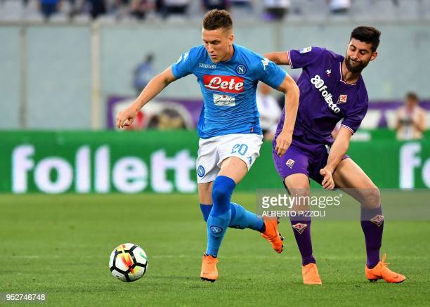 Napoli's Polish midfielder Piotr Zielinski outruns Fiorentina's midfielder Marco Benassi during the Italian Serie A football match Fiorentina vs...