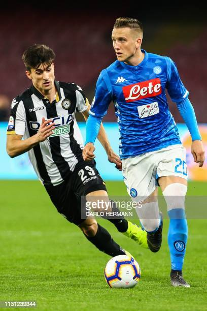 Napoli's Polish midfielder Piotr Zielinski outruns Udinese's Argentine forward Ignacio Pussetto during the Italian Serie A football match Napoli vs...