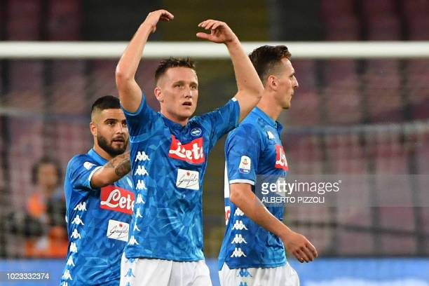 Napoli's Polish midfielder Piotr Zielinski reacts after scoring during the Italian Serie A football match Napoli vs AC Milan on August 25 2018 at the...