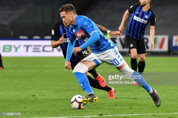 Napoli's Polish midfielder Piotr Zielinski runs with the ball during the Italian Serie A football match Napoli vs Inter Milan at the San Paolo...