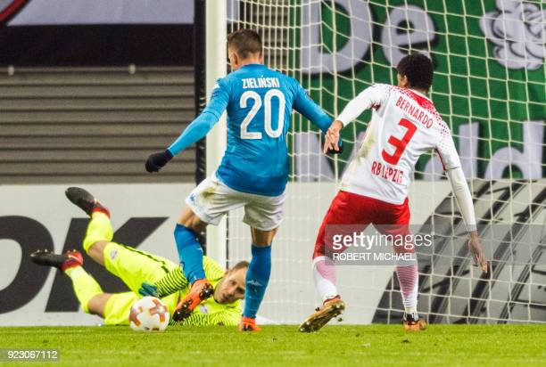 Napoli's Polish midfielder Piotr Zielinski scores next to Leipzig's Hungarian goalkeeper Peter Gulacsi and Brazilian defender Bernardo Fernandes da...