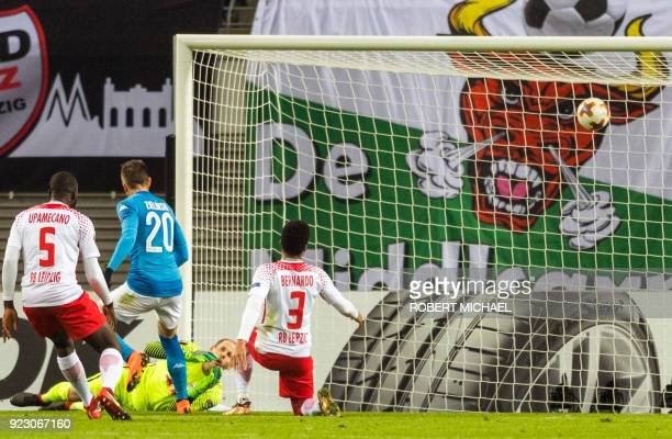 Napoli's Polish midfielder Piotr Zielinski scores next to Leipzig's Hungarian goalkeeper Peter Gulacsi Brazilian defender Bernardo Fernandes da Silva...