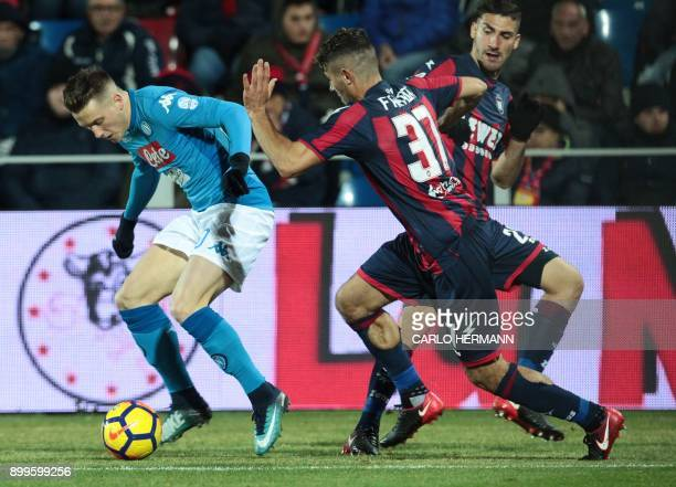 Napoli's Polish midfielder Piotr Zielinski vies with Crotone's Italian defender Davide Faraoni during the Italian Serie A football match FC Crotone...
