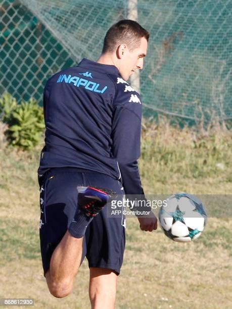 Napoli's Polish striker Arkadiusz Milik controls the ball during a training session on the eve of the UEFA Champions League Group F football match...