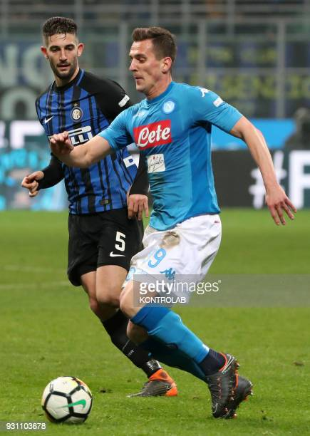 STADIUM MILAN LOMBARDIA ITALY Napoli's Polish striker Arkadiusz Milik fights for the ball with Inter Milan's Italian midfielder Roberto Gagliardini...