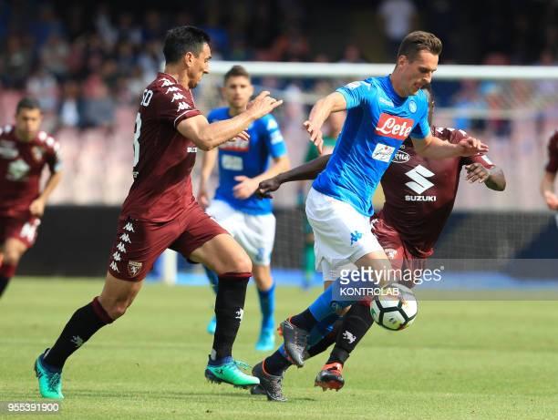 STADIUM NAPLES CAMPANIA ITALY Napoli's Polish striker Arkadiusz Milik fights for the ball with Torino's Italian midfielder Daniele Baselli during the...