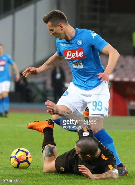 STADIUM NAPLES CAMPANIA ITALY Napoli's Polish striker Arkadiusz Milik fights for the ball with Roma's Belgian midfielder Radja Nainggolan during the...