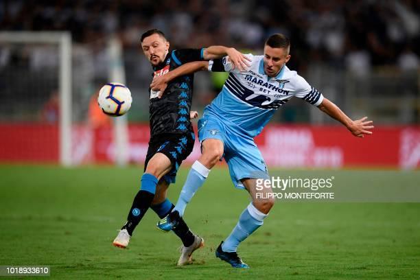 Napoli's Portuguese defender Mario Rui and Lazio's Montenegrin midfielder Adam Marusic go for the ball during the Italian Serie A football match...