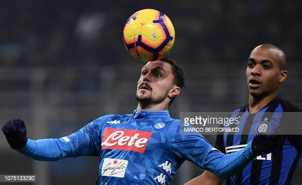 TOPSHOT Napoli's Portuguese defender Mario Rui head controls the ball ahead of Inter Milan's Portuguese midfielder Joao Mario during the Italian...