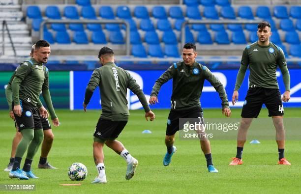 Napoli's Portuguese defender Mario Rui Napoli's Italian forward Lorenzo Insigne Napoli's Mexican forward Hirving Lozano and Napoli's Greek defender...
