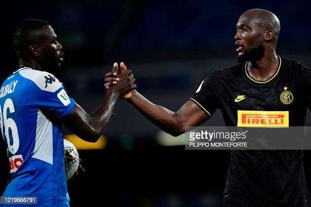 Napoli's Senegalese defender Kalidou Koulibaly and Inter Milan's Belgian forward Romelu Lukaku shake hands at the end of the Italian Cup semi-final...