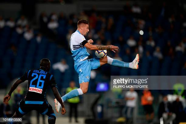 TOPSHOT Napoli's Senegalese defender Kalidou Koulibaly and Lazio's Serbian midfielder Sergej MilinkovicSavic go for the ball during the Italian Serie...