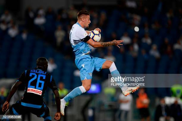 Napoli's Senegalese defender Kalidou Koulibaly and Lazio's Serbian midfielder Sergej MilinkovicSavic go for the ball during the Italian Serie A...
