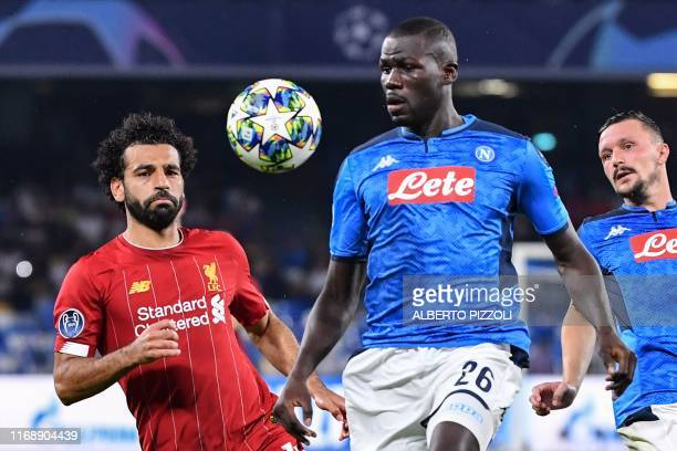 Napoli's Senegalese defender Kalidou Koulibaly and Liverpool's Egyptian midfielder Mohamed Salah go for the ball during the UEFA Champions League...
