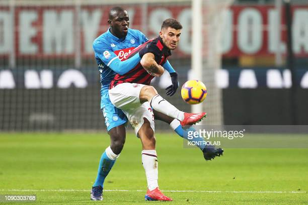 STADIUM MILAN LOMBARDIA ITALY Napoli's Senegalese defender Kalidou Koulibaly and Milan's Italian forward Patrick Cutrone fights for the ball during...