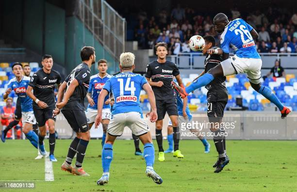 Napoli's Senegalese defender Kalidou Koulibaly and Sampdoria's Colombian defender Jeison Murillo go for a header during the Italian Serie A football...
