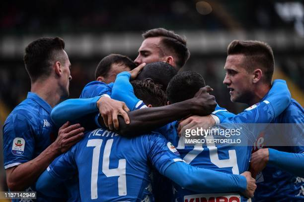 Napoli's Senegalese defender Kalidou Koulibaly celebrates with teammates after opening the scoring during the Italian Serie A football match Chievo...
