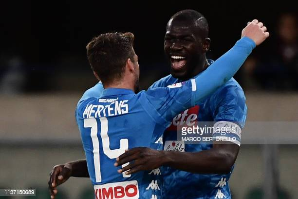 Napoli's Senegalese defender Kalidou Koulibaly celebrates with Napoli's Belgian forward Dries Mertens after scoring his second goal during the...