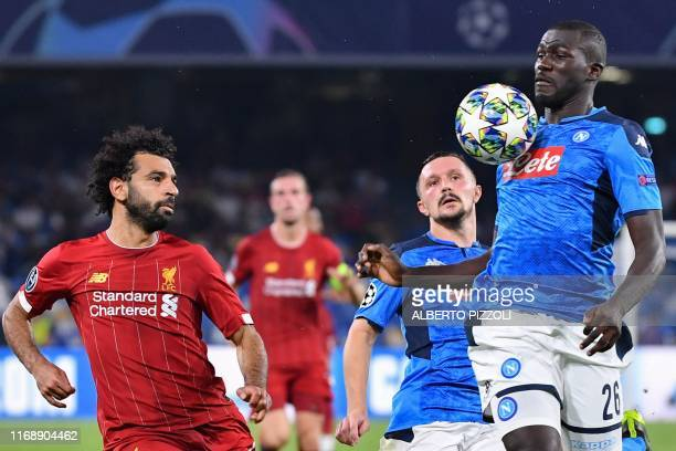 Napoli's Senegalese defender Kalidou Koulibaly chest controls the ball under pressure from Liverpool's Egyptian midfielder Mohamed Salah as Napoli's...