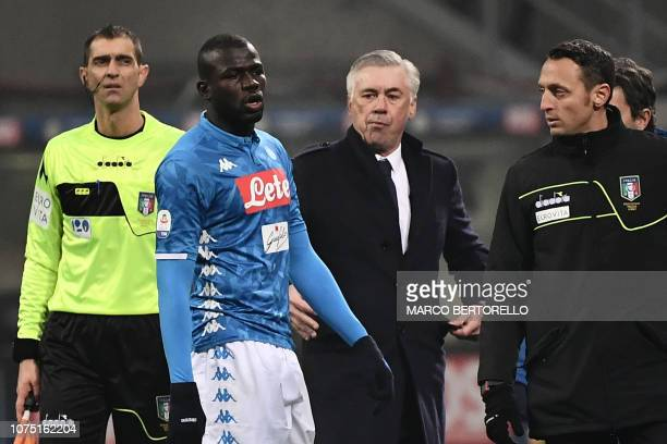 Napoli's Senegalese defender Kalidou Koulibaly exits the pitch after receiving a red card as Napoli's Italian coach Carlo Ancelotti looks on during...