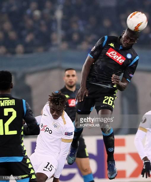 STADIUM ZURICH SWITZERLAND Napoli's Senegalese defender Kalidou Koulibaly heads the ball next to Zurich Nigerian forward Stephen Odey during the UEFA...