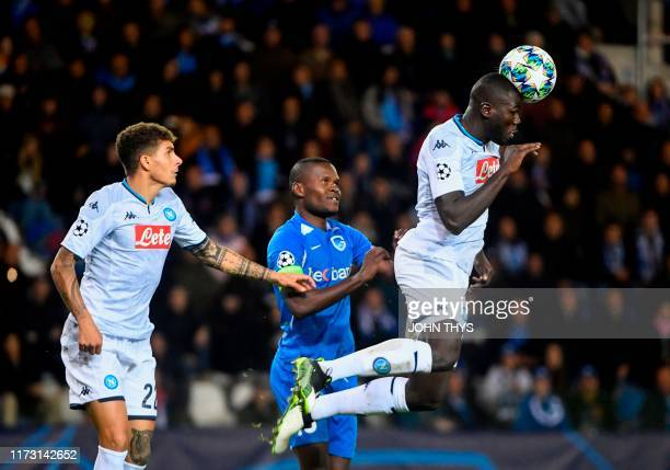 Napoli's Senegalese defender Kalidou Koulibaly jumps for the ball during the UEFA Champions League Group E football match between Napoli and RC Genk...