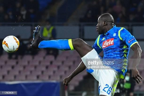 Napoli's Senegalese defender Kalidou Koulibaly kicks the ball during the UEFA Europa League round of 16 first leg football match Napoli vs Salzburg...