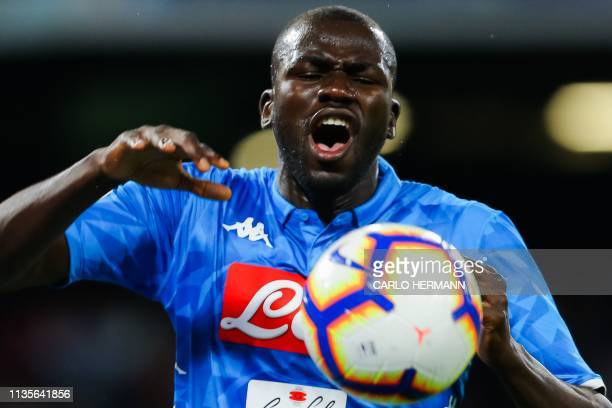 Napoli's Senegalese defender Kalidou Koulibaly reacts after missing a goal opportunity during the Italian Serie A football match Napoli vs Genoa on...