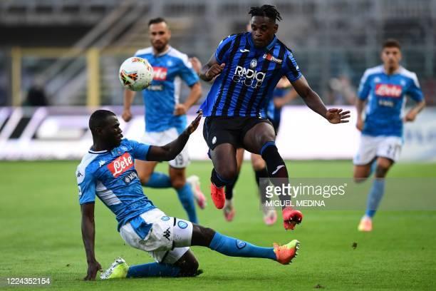 Napoli's Senegalese defender Kalidou Koulibaly tackles Atalanta's Colombian forward Duvan Zapata during the Italian Serie A football match Atalanta...