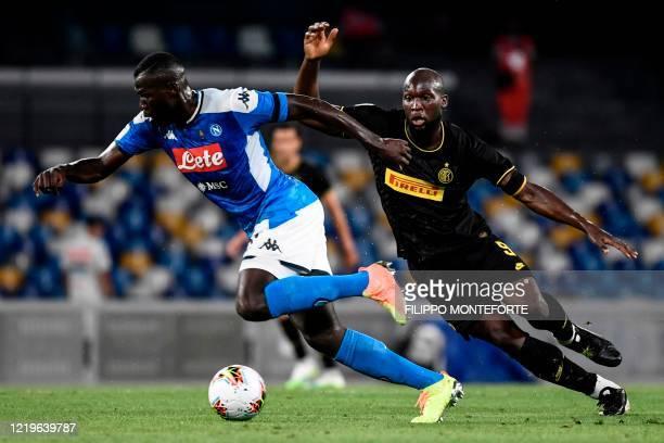 Napoli's Senegalese defender Kalidou Koulibaly works around Inter Milan's Belgian forward Romelu Lukaku during the Italian Cup semi-final second leg...