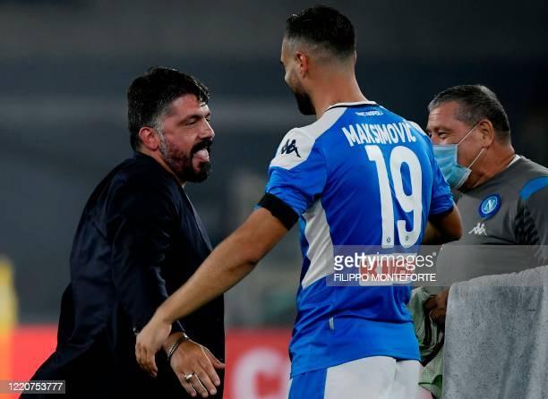 Napoli's Serbian defender Nikola Maksimovic and Napoli's Italian head coach Gennaro Gattuso celebrate after Napoli won the penalty shootout of the...