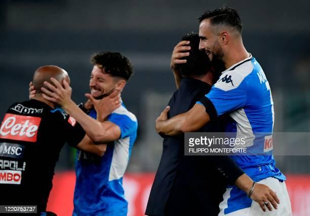 Napoli's Serbian defender Nikola Maksimovic embraces Napoli's Italian head coach Gennaro Gattuso after Napoli won the penalty shootout of the TIM...