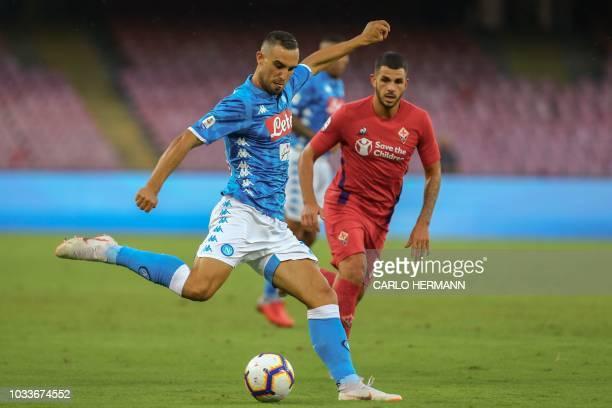 Napoli's Serbian defender Nikola Maksimovic kicks the ball next to Fiorentina's French midfielder Valentin Eysseric during the Italian Serie A...